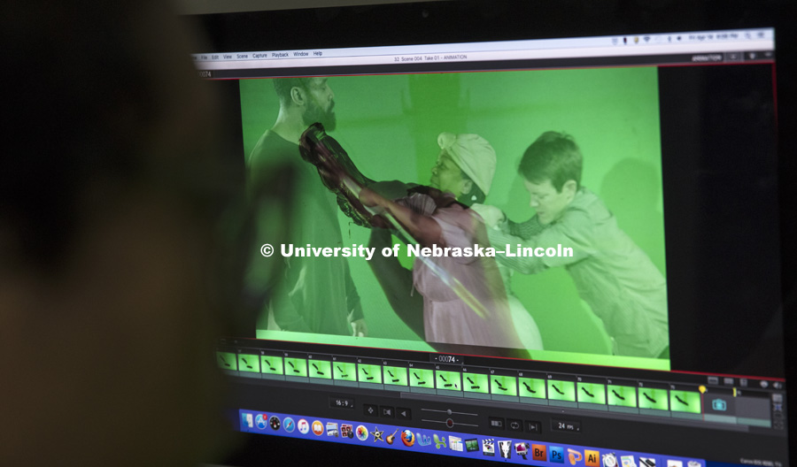 A computer screen shows an image of Thalia Rodgers' hand and brush as she creates an animation by painting over a live-action scene with a technique called rotoscoping. Rodgers is a student member of a team at Nebraska that is creating an animated film