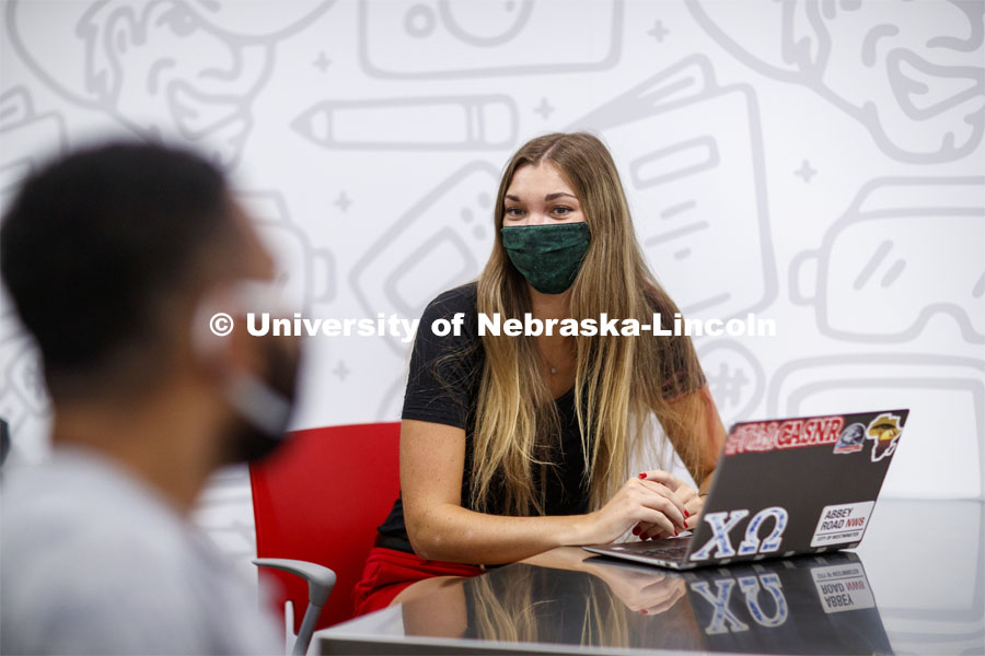 Students wear masks as they study in the Lynn and Dana Roper Media Studio in Anderson Hall. Photo shoot of students wearing masks and practicing social distancing. August 11, 2020 Photo by Craig Chandler / University Communication.
