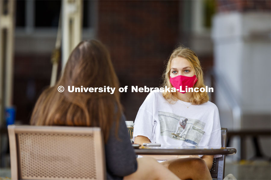 Young women hanging out at the Plaza near the Nebraska Union. Wearing masks on city campus. September 21, 2020. Photo by Craig Chandler / University Communication.