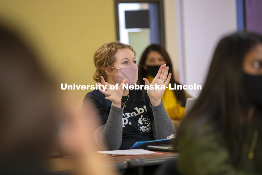 A student interacts with Professor Crystal Garcia during the CEHS Educational Administration class: College Students in America. November 10, 2020. Photo by Craig Chandler / University Communication.