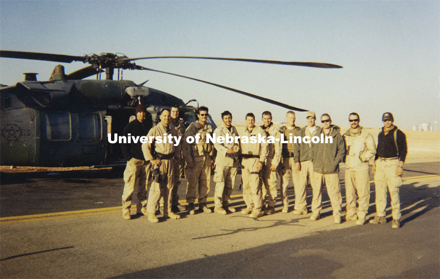 Air Force Senior Master Sargent Mike Miller is a CEHS enrollment advisor during his last months of active duty before retiring from the military this January. He is the sixth from right in this photo of the two helicopters crews that effected the Rescue of Junker 14.  An F-14 was shot down during the opening hours of Operation Iraqi Freedom in 2003 and I was on the lead helicopter that picked up the pilot and his REO. He was awarded the air medal for the rescue. January 14, 2021. Photo by Craig Chandler / University Communication.