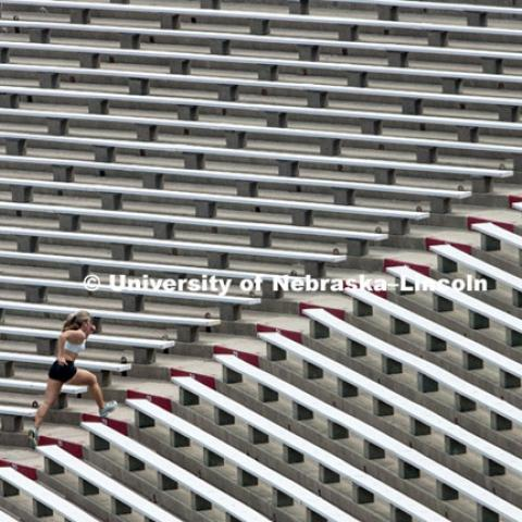 Athletes running stairs in Memorial Stadium, August 23, 2012.  Photo by Craig Chandler / University Communications