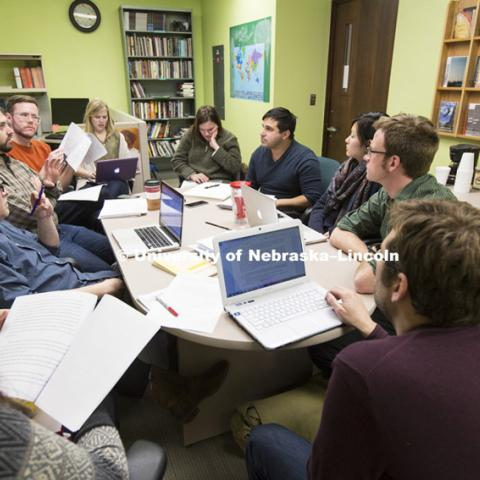 Ashley Strosnider working with staff to choose stories for the next issue of Prairie Schooner. February 23, 2015. Photo by Craig Chandler / University Communications.