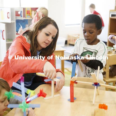Monica Meyer, senior in Inclusvie Child Youth and Family Studies, works with children at the Malone Center. Ruth Staples Child Development Lab student teachers and children work with children at the Malone Center. Febrary 28, 2019. Photo by Craig Chandler / University Communication