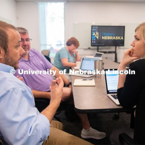Aaron Johnson (left), assistant professor of teaching, learning and education, brainstorms with LPS educators Brad Irvine and Jaci Kellison about ways to incorporate History Harvest into the classroom. June 5, 2019. Photo by Gregory Nathan / University Communication.
