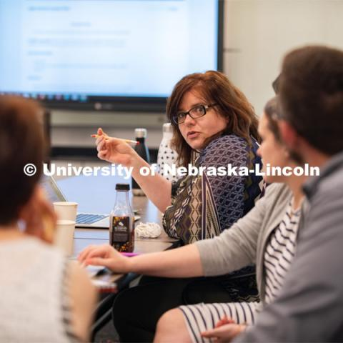 Stacey Haney, a teacher at Humann Elementary, talks with colleagues about classroom opportunities for History Harvest during the teacher institute held June 3-5. June 5, 2019. Photo by Gregory Nathan / University Communication.