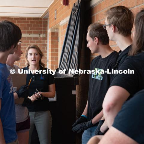 Brittney Albin (center), sustainability coordinator for Lincoln Public Schools, speaks with University of Nebraska-Lincoln students prior to starting a waste audit at Lincoln Southwest High School. September 25, 2019. Photo by Greg Nathan / University Communication.
