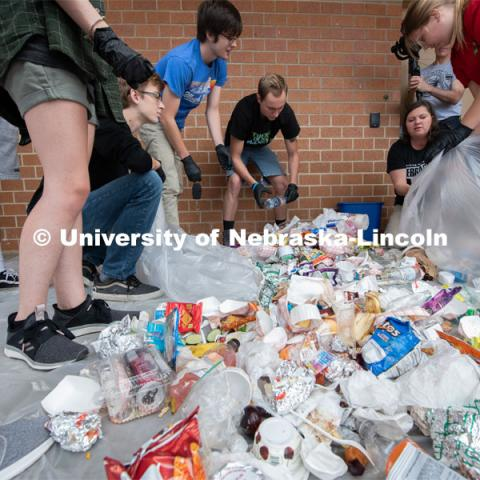 Students from the Environmental Studies Orientation class, including Luke Stursma, (lower left) William Raney, Leo Schwantz, instructor Christine Haney Douglass and Anna Janda sort refuse from lunch at Lincoln Southwest High School. September 25, 2019. Photo by Greg Nathan / University Communication.