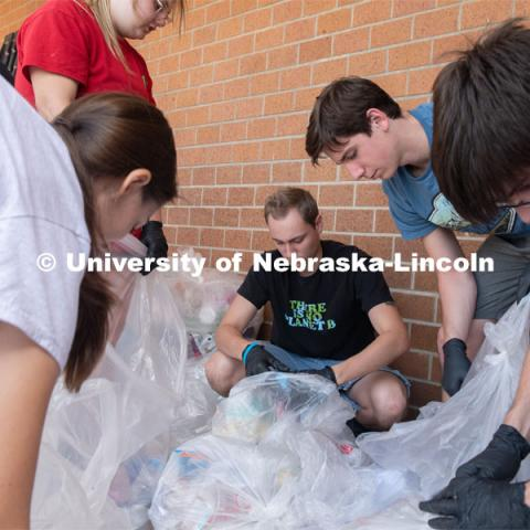 Students from the Environmental Studies Orientation class, sort refuse from lunch at Lincoln Southwest High School. September 25, 2019. Photo by Greg Nathan / University Communication.