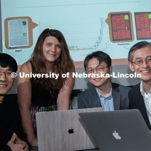 Members of the Aida lab (from left) Chulwood Pack, graduate student; Elizabeth Lorang, associate professor in University Libraries; Yi Liu, graduate student; and Leen-Kiat Soh, professor of computer science and engineering, recently completed research on using machine learning in digital libraries for the United States Library of Congress. October 7, 2019. Photo by Gregory Nathan / University Communication.