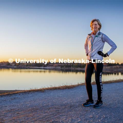 Sue Sheridan, director of the Nebraska Center for Research on Children, Youth, Families and Schools, is on a mission to run marathons or half-marathons in all 50 states. Sheridan is running in support of her nonprofit, Elevating Haitian Education. Sue is pictured running at Holmes Lake Park in Lincoln, Nebraska. December 4, 2019. Photo by Craig Chandler / University Communication.