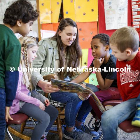 Megan Groth, sophomore in Speech-Language Pathologist, reads to first graders at Saratoga Elementary school as part of the America Reads / America Counts project. December 5, 2019. Photo by Craig Chandler / University Communication.