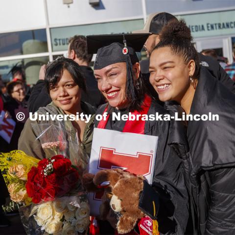 Athena Muhs and her family pose for photos after commencement. December Undergraduate commencement at Pinnacle Bank Arena. December 21, 2019. Photo by Craig Chandler / University Communication.