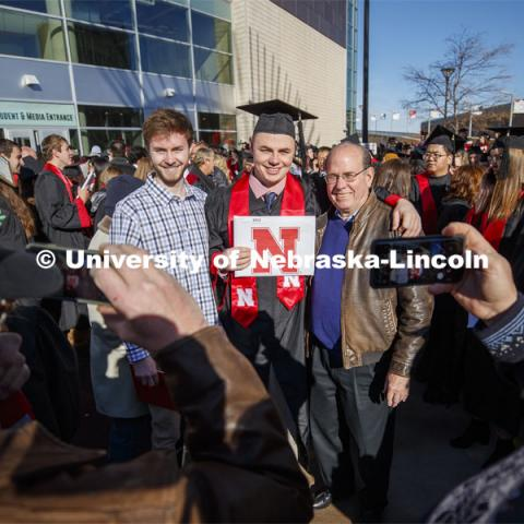 Stephen Lunde poses with family and friends after graduating with his PGA Golf Management degree. December Undergraduate commencement at Pinnacle Bank Arena. December 21, 2019. Photo by Craig Chandler / University Communication.