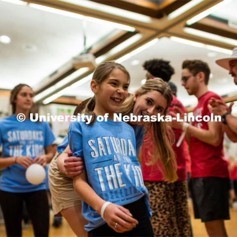 "Miracle children and their families are excited as they run through the tunnel walk created by the students. University of Nebraska–Lincoln students exceeded their goal, raising $235,229 during the annual HuskerThon on Feb. 29. Also known as Dance Marathon, the event is part of a nationwide fundraiser supporting Children's Miracle Network Hospitals. The annual event, which launched in 2006, is the largest student philanthropic event on campus. The mission of the event encourages participants to, ""dance for those who can't."" All funds collected by the Huskers benefit the Children's Hospital and Medical Center in Omaha. February 29, 2020. Photo by Justin Mohling / University Communication."
