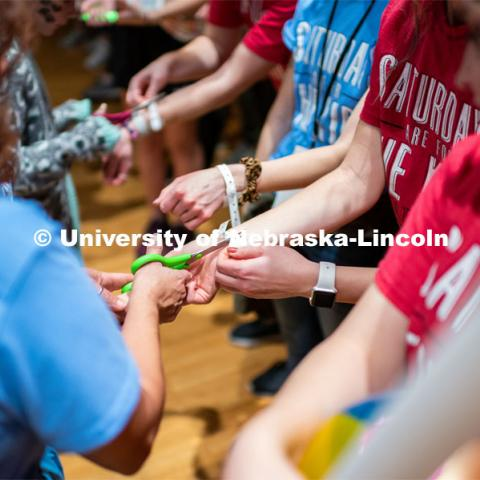 "Students getting their symbolic wristbands cut off by miracle children. University of Nebraska–Lincoln students exceeded their goal, raising $235,229 during the annual HuskerThon on Feb. 29. Also known as Dance Marathon, the event is part of a nationwide fundraiser supporting Children's Miracle Network Hospitals. The annual event, which launched in 2006, is the largest student philanthropic event on campus. The mission of the event encourages participants to, ""dance for those who can't."" All funds collected by the Huskers benefit the Children's Hospital and Medical Center in Omaha. February 29, 2020. Photo by Justin Mohling / University Communication."