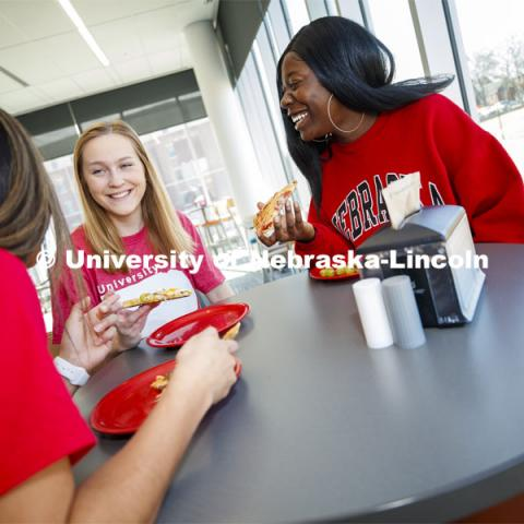 Cather Dining Center photoshoot. Young women eating together in the Cather Dining Center. March 2, 2020 Photo by Craig Chandler / University Communication.