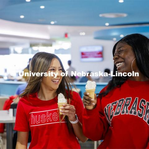 Cather Dining Center photoshoot. Young women eating ice cream in the Cather Dining Center. March 2, 2020 Photo by Craig Chandler / University Communication.