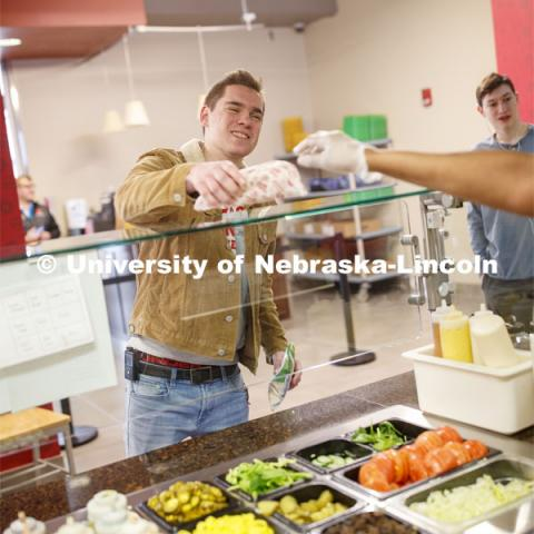 Abel Sandoz Dining Center photo shoot. Student's pick up their order at Husker Heroes. March 3, 2020. Photo by Craig Chandler / University Communication.