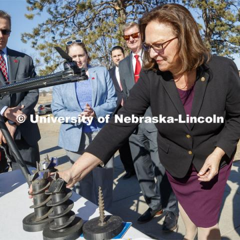 Senator Deb Fischer looks over auger bits used by NIMBUS Lab drones to implant remote sensors. Senator Deb Fischer was given a demonstration of the drilling drone as part of her tour at UNL Friday afternoon. March 6, 2020. Photo by Craig Chandler / University Communication.