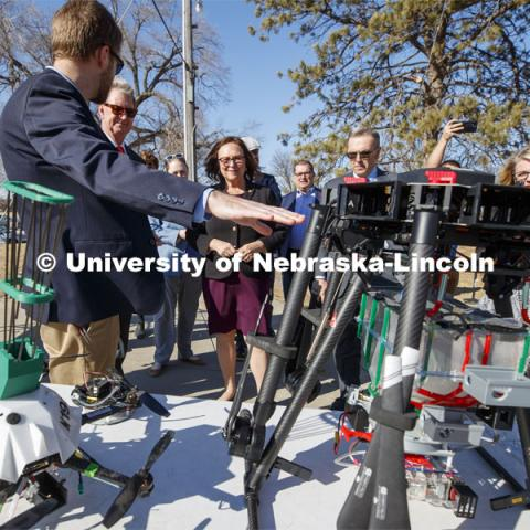Carrick Detweiler shows Senator Deb Fischer, center, the progression of drones designed to start controlled burns to aid forest fighters and help with conservation. At left is NU President Ted Carter and at right is UNL Chancellor Ronnie Green.  March 6, 2020. Photo by Craig Chandler / University Communication.