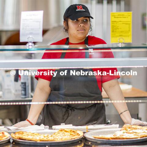 Anagha Deshmankar is a student worker in the Willa Cather Dining Center on City Campus. April 7, 2020. Photo by Craig Chandler / University Communication.