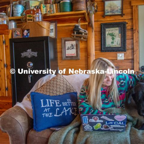 Katie Bresnahan does remote learning from her home in Hordville, NE, despite distractions from her dog, Wrex. As a result of the Corona virus, Katie is studying from home. April 9, 2020. Photo by Katie Bresnahan for University Communication.