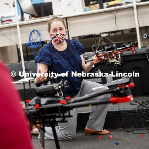 Brittany Duncan, assistant professor of Computer Science and Engineering, discusses drone equipment in the Nimbus Lab. Brittany is wearing a mask for protection from the COVID-19 pandemic. June 23, 2020. Photo by Craig Chandler / University Communication.