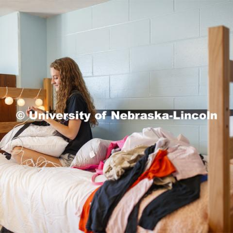 Breeana Read of Omaha plugs her phone charger in as she decorates her room. First day of residence hall move in. August 13, 2020. Photo by Craig Chandler / University Communication.