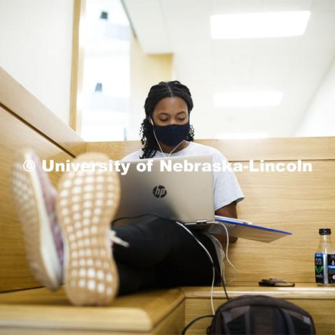 Kyra Baptiste studies in the foyer of the College of Business. September 14, 2020. Photo by Craig Chandler / University Communication.
