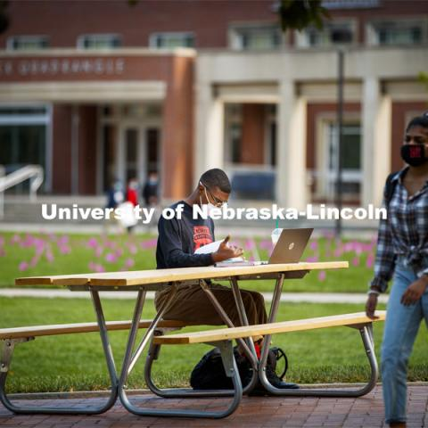 Seth Caines works on his chemistry homework on the greenspace outside the Nebraska Union. City Campus. October 5, 2020. Photo by Craig Chandler / University Communication.