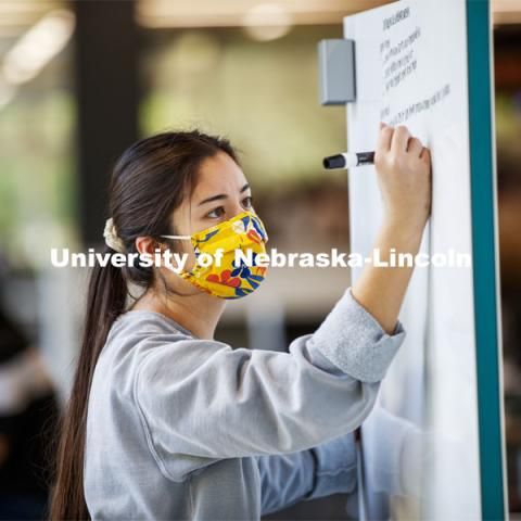 Madison Han, senior in Nutritional Science and Dietetics, uses a white marker board in the Adele Coryell Hall Learning Commons to work on her anatomy homework. City Campus. October 5, 2020. Photo by Craig Chandler / University Communication.