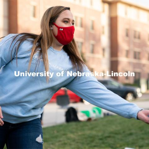 Baylee Gerber throws a beanbag during the ASUN Cornhole Competition at the Cather-Pound Greenspace on Wednesday, October 28, 2020, in Lincoln, Nebraska. Photo by Jordan Opp for University Communication.