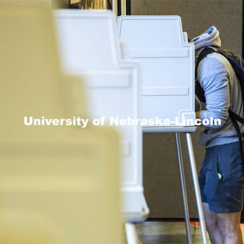 Hunter Parker, from Los Angeles, ponders the ballot as he votes in his first presidential election. Voting in the Nebraska Union for the 2020 Presidential Election. November 3, 2020. Photo by Craig Chandler / University Communication.