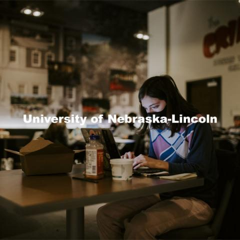 Madeline Reddel, a senior from Omaha, studies in the Crib in the Nebraska Union. City campus. November 11, 2020. Photo by Craig Chandler / University Communication.