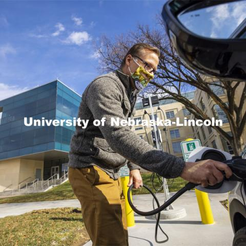 Dan Carpenter, Director of Parking and Transit Services, plugs in a Chevy Bolt to charge at the new charging station in front of Howard Hawks Hall. There are four new charging stations on the UNL campuses. The stations are capable of charging Teslas, along with other popular brands of electric vehicles. November 12, 2020.  Photo by Craig Chandler / University Communication.