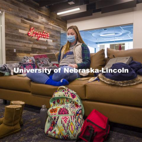Lucy Kimball studies in the new Engler Agribusiness Entrepreneurship Program space on the second floor of the Dinsdale Family Learning Commons on East Campus. January 28, 2021. Photo by Craig Chandler / University Communication.