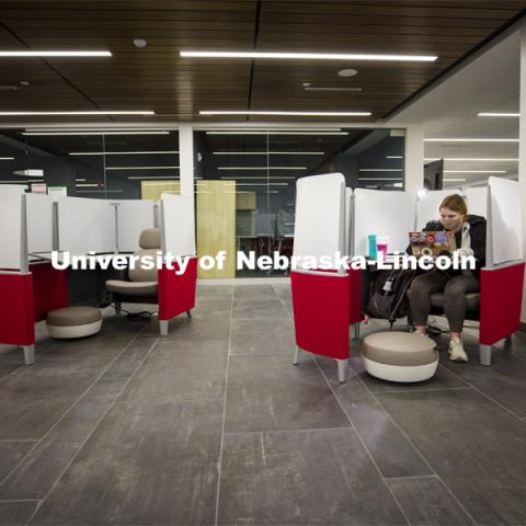 Taylor Ruwe, a freshman from Hooper, NE, studies in a pod similar to a first-class airline seat in the lower level of the Dinsdale Family Learning Commons on East Campus. January 28, 2021. Photo by Craig Chandler / University Communication.