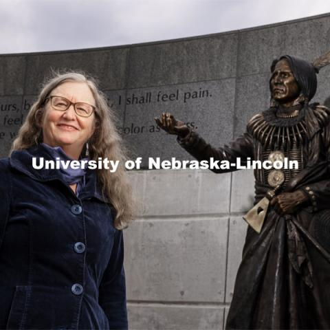 Margaret Jacobs, Chancellor's Professor of History; Director, Center for Great Plains Studies, with the statue of Chief Standing Bear. University of Nebraska-Lincoln. March 12, 2021. Photo by Craig Chandler / University Communication.