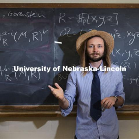 Jack Jeffries, assistant professor of mathematics, is a NSF CAREER winner. On the blackboard are some computations of Bernstein-Sato roots. His research is in Commutative Algebra including invariant theory, positive characteristic techniques, differential operators, local cohomology, generalized multiplicities, symbolic powers, and applications to neuroscience. March 31, 2021. Photo by Craig Chandler / University Communication