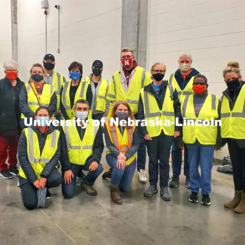 The first group of more than 150 UNL faculty, student and staff members volunteering at the COVID vaccine clinic at Pinnacle Bank Arena this week. April 7, 2021. Photo by Jesse Brophy / University Communication.