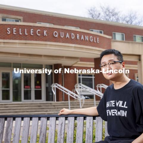 Tamayo Zhou for Husker Dialogues. Zhou poses in front of the Selleck Quadrangle. April 27, 2021. Photo by Craig Chandler / University Communication.