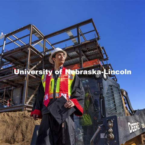 Yajyoo Shrestha, a graduating senior in civil engineering, stands before the construction site of the new College of Education and Human Sciences building on City Campus. April 29, 2021. Photo by Craig Chandler / University Communication.